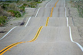 A road with lots of ups and downs and bumps.
