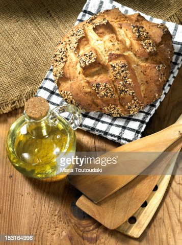 Bun of bread and bottle of olive oil : Stock Photo