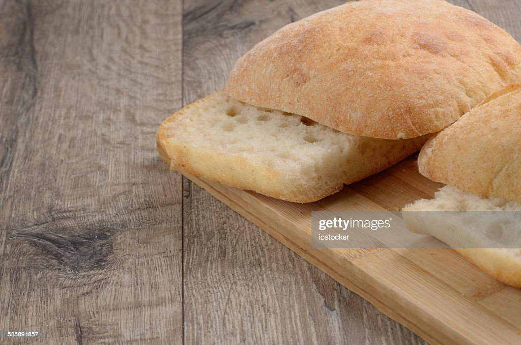 Bun on cut board : Stock Photo