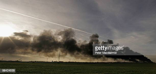 Buncefield oil depot continues to burn for a third day on December 13 2005 in Hemel Hempstead England Fire fighters hope to extinguish the remaining...