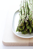 Bunch of asparagus on plate, close-up