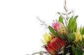 Bunch of Australian Native flowers with banksia and proteas against white background with copy space