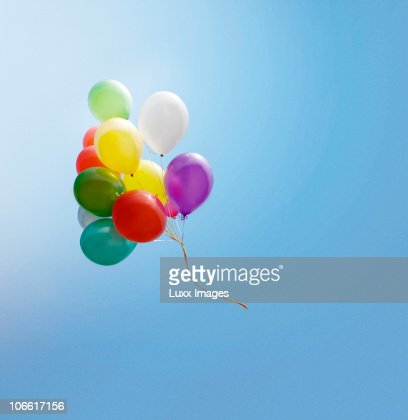 Bunch of balloons flying in the blue sky