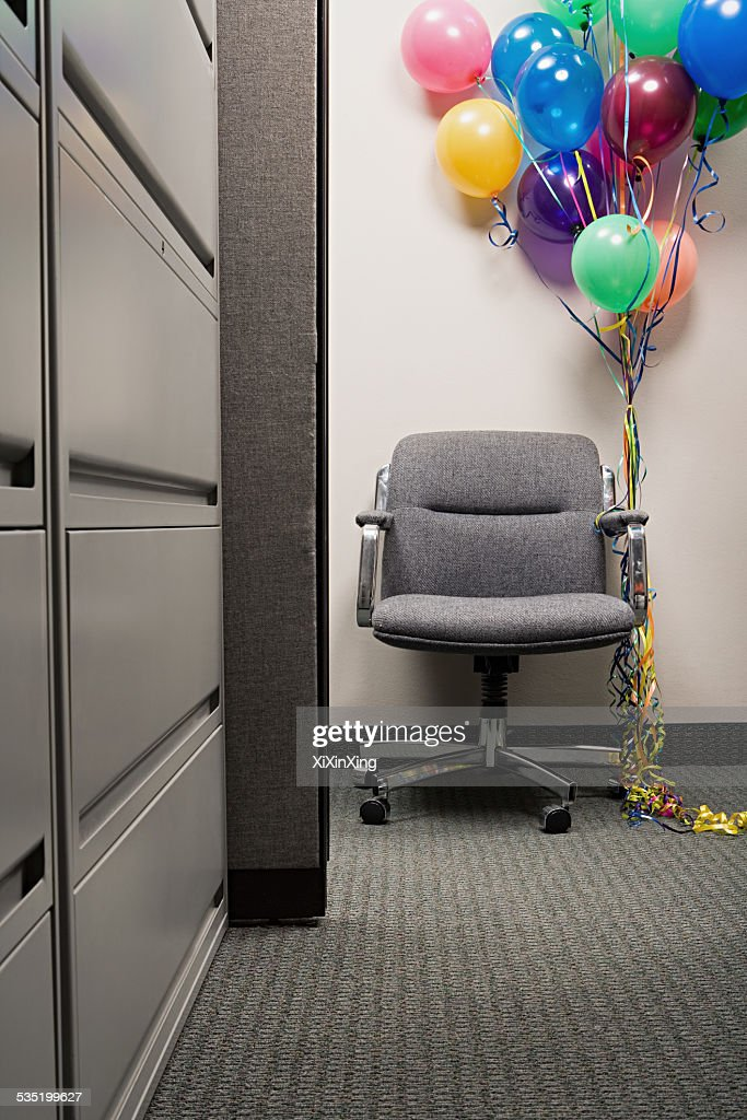 bunch of balloons tied to office chair stock photo thinkstock rh thinkstockphotos ae Antique Balloon Chair Dome Chair