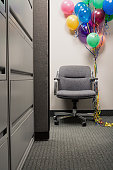 Bunch of balloons tied to office chair