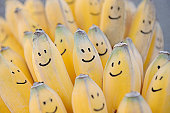 Bunch of bananas with faces drawn on them