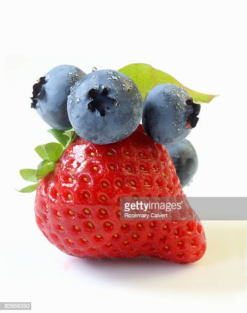 Bunch of blueberries 'bluecrop' on strawberry