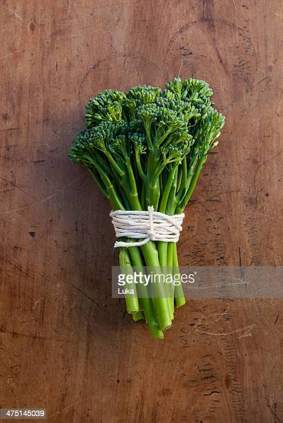 Bunch of broccoli tied with string, still life