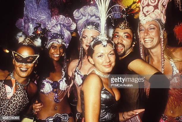 A bunch of cabaret girls wearing headgear and masks Ibiza 1998
