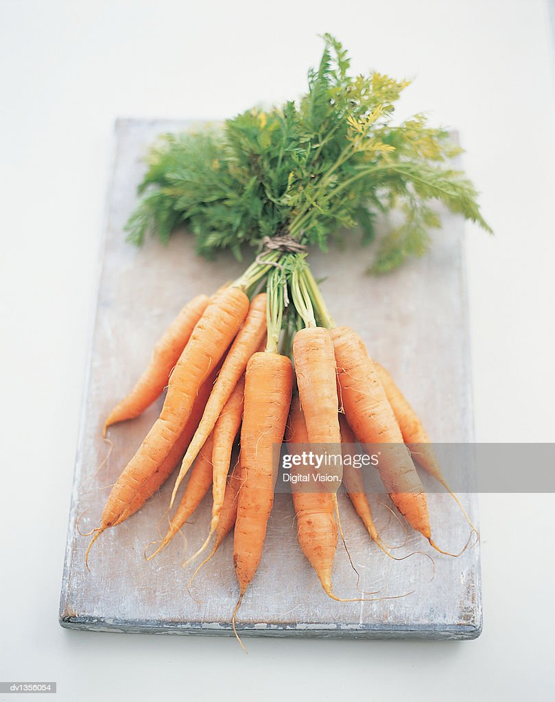 Bunch of Carrots on a Chopping Board : Stock Photo