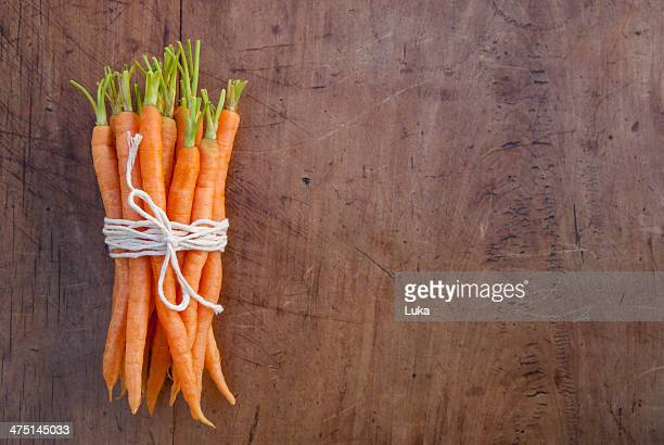 Bunch of carrots tied with string, still life