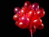 Bunch of floating red balloons