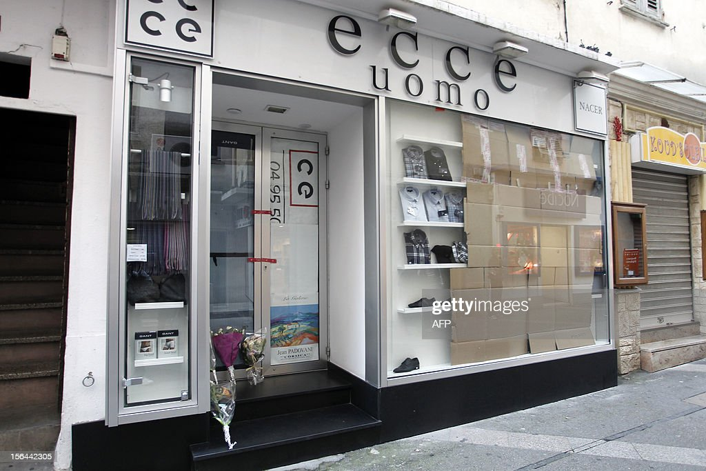 Bunch of flowers have been set at the front dooer of the retail shop of Jacques Nacer, a chamber of Commerce and Industry (CCI)'s local president who was found shot dead in front of his store the day before, on November 15, 2012 in Ajaccio.