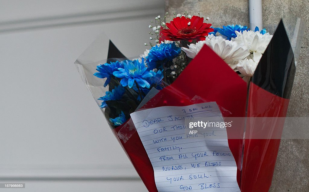 A bunch of flowers is left outside the nurses accommodation block by colleagues near the King Edward VII hospital in central London on December 8, 2012 in memory of nurse Jacintha Saldanha who was found dead the previous day. A nurse at the hospital which treated Prince William's pregnant wife Catherine, Duchess of Cambridge, was found dead on December 7, days after being duped by a hoax call from an Australian radio station, the hospital said. Police said they were treating the death, which happened at a property near the hospital, as unexplained.