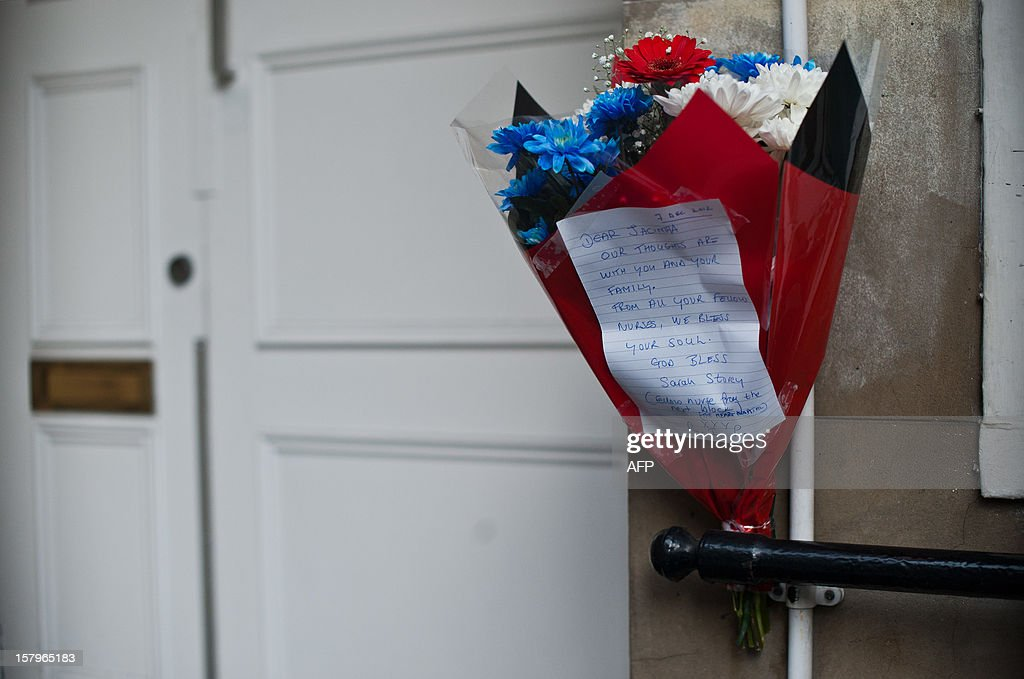 A bunch of flowers is left outside the nurses accommodation block by colleagues near the King Edward VII hospital in central London on December 8, 2012 in memory of nurse Jacintha Saldanha who was found dead the previous day. A nurse at the hospital which treated Prince William's pregnant wife Catherine, Duchess of Cambridge, was found dead on December 7, days after being duped by a hoax call from an Australian radio station, the hospital said. Police said they were treating the death, which happened at a property near the hospital, as unexplained. AFP PHOTO / WILL OLIVER
