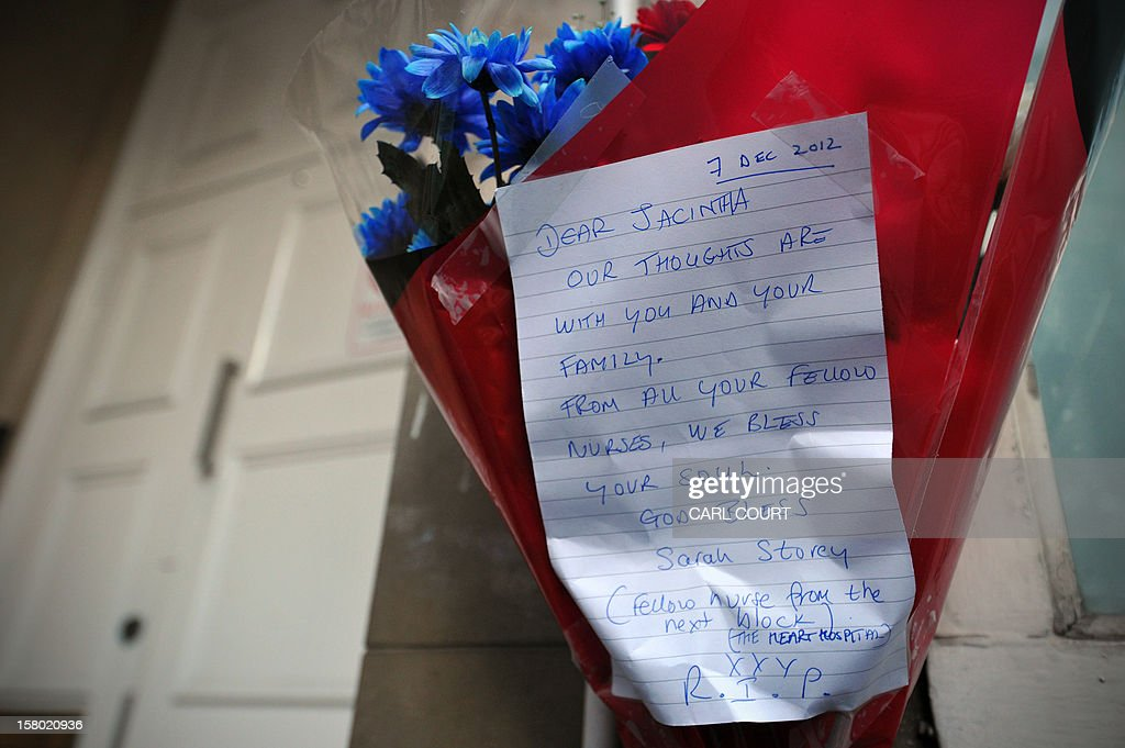 A bunch of flowers is left outside the nurses accommodation block by colleagues near the King Edward VII hospital in central London on December 9, 2012 in memory of Indian-origin nurse Jacintha Saldanha who was found dead the previous day. A nurse at the hospital which treated Prince William's pregnant wife Catherine, Duchess of Cambridge, was found dead on December 7, days after being duped by a hoax call from an Australian radio station, the hospital said. Police said they were treating the death, which happened at a property near the hospital, as unexplained.