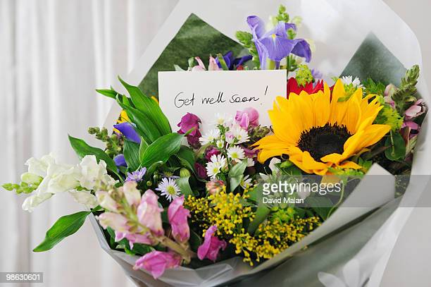 Bunch of flowers with 'Get well soon' message.