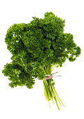 A bunch of fresh green parsley on white background. Studio Photo