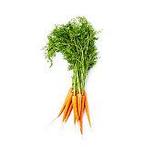 Bunch of Fresh Organic Carrots on whitebackground; flat lay
