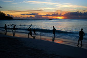 Cricket game at the beach with a beautiful sunset