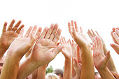 A group of people with their arms raised