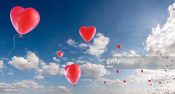 Bunch of heart shaped balloons appearing from horizon