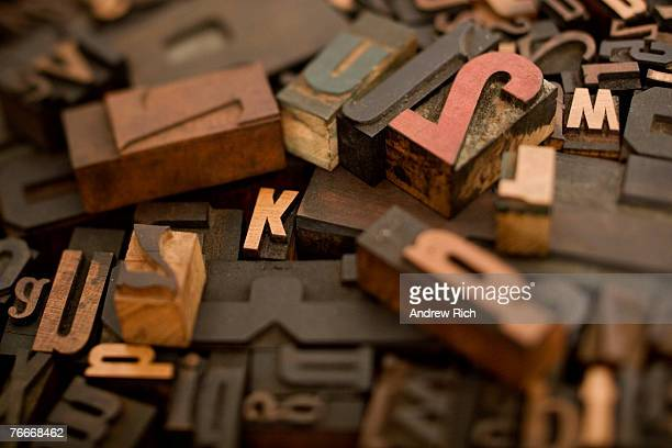 A bunch of old and different wood type letters. Taken with a tilt-shift lens.