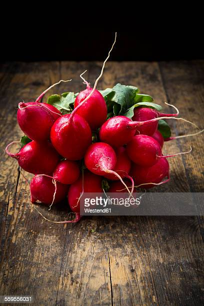 Bunch of organic radish on wood