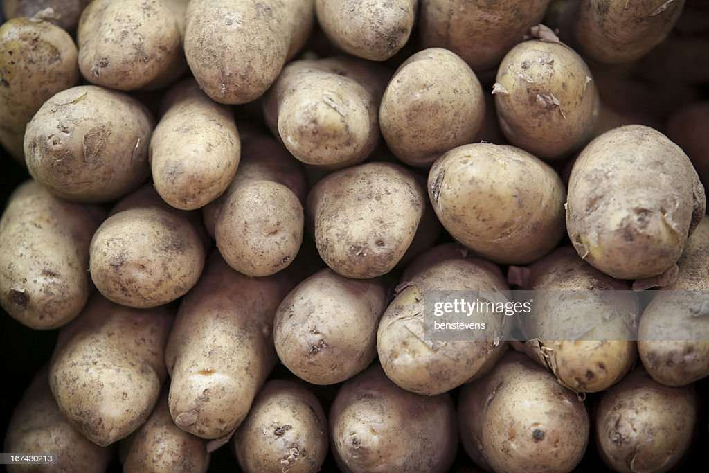 Bunch of Raw Russet Potatoes at a Market : Stock Photo