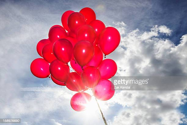 Bunch of red balloons in blue sky