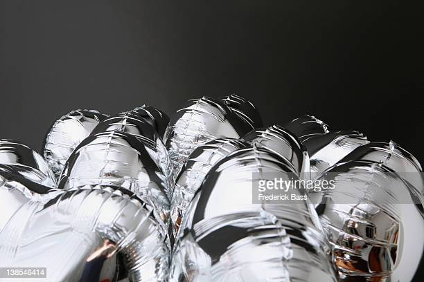 A bunch of silver helium balloons