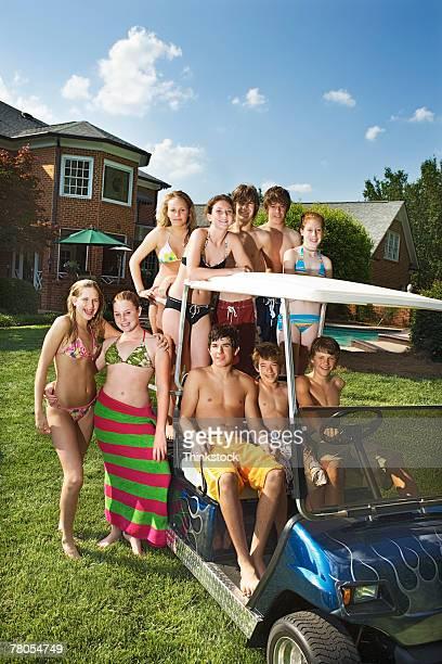Bunch of teenagers in golf cart