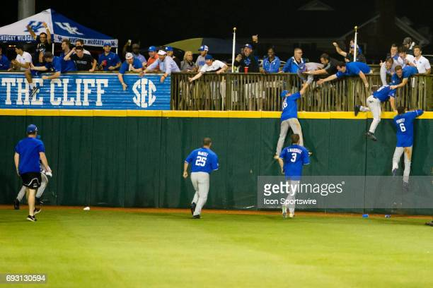 A bunch of the Kentucky players ran out and climbed the right center field wall in appreciation of the fans after their Regional win after the...