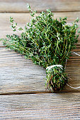 Bunch thyme on wooden boards, close up