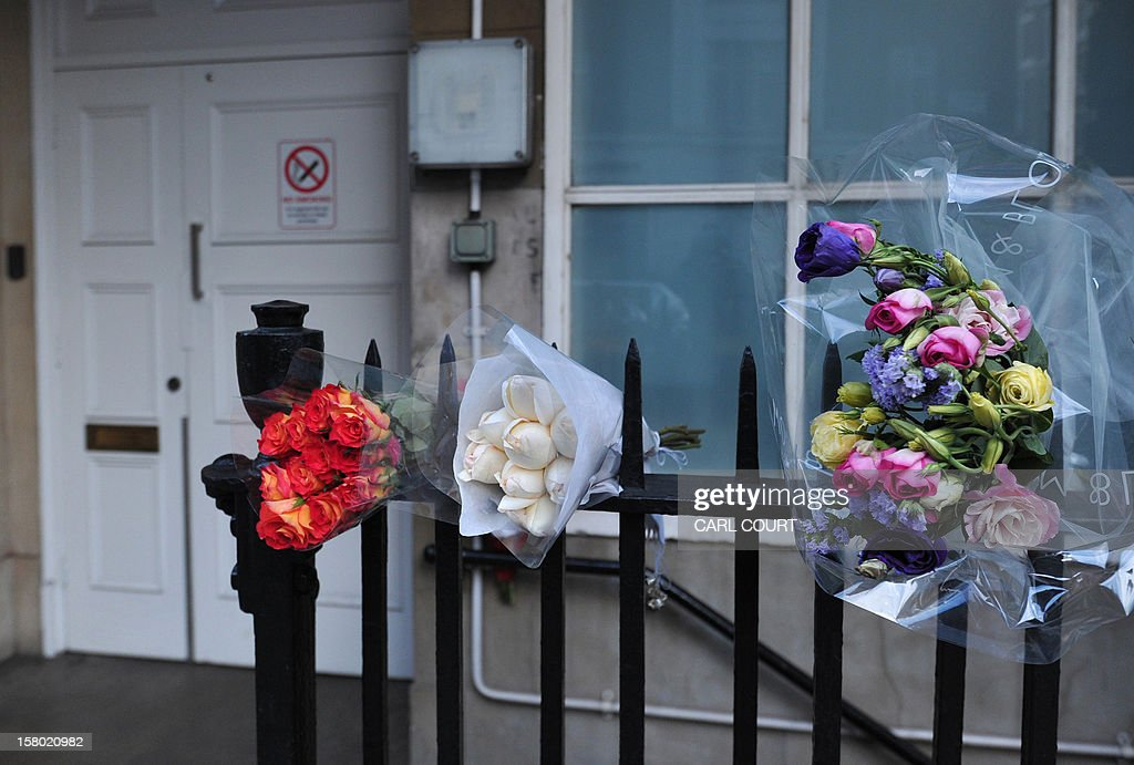 Bunches of flowers are left outside the nurses accommodation block near the King Edward VII hospital in central London on December 9, 2012 in memory of Indian-origin nurse Jacintha Saldanha who was found dead two days ago. A nurse at the hospital which treated Prince William's pregnant wife Catherine, Duchess of Cambridge, was found dead on December 7, days after being duped by a hoax call from an Australian radio station, the hospital said. Police said they were treating the death, which happened at a property near the hospital, as unexplained.