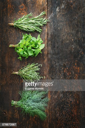 Bunches of fresh rosemary, mint, thyme and dill
