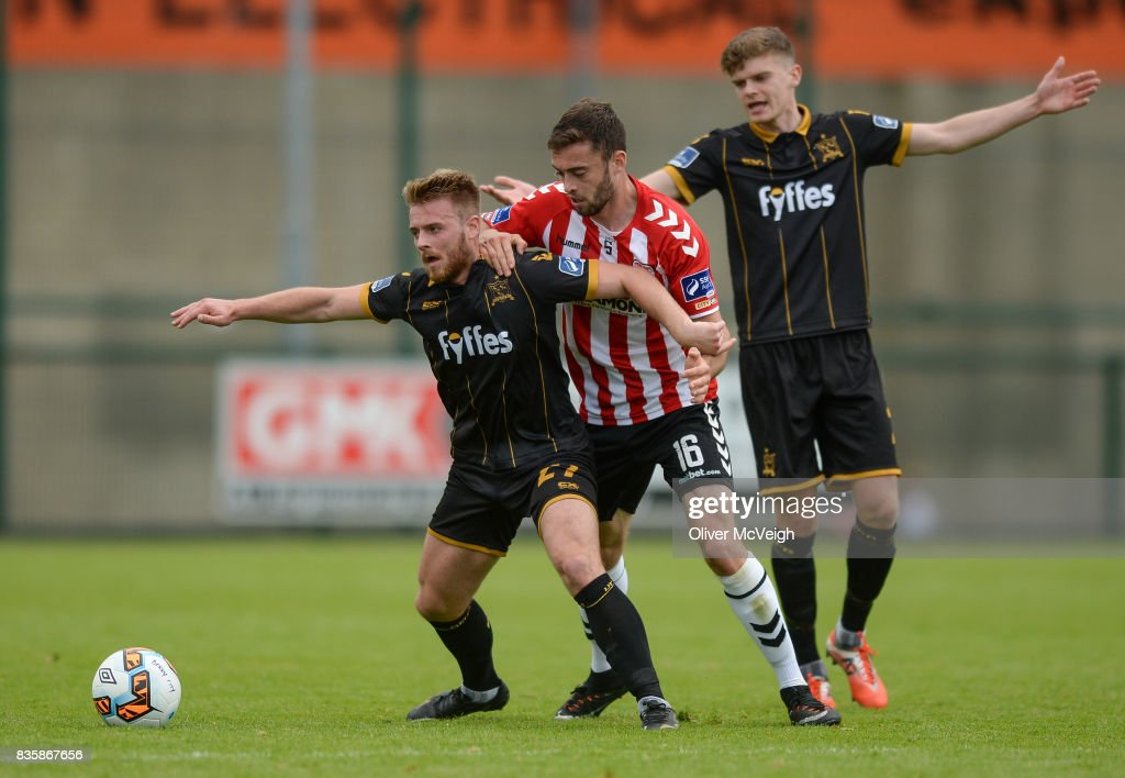 Buncrana , Ireland - 20 August 2017; Conor Clifford of Dundalk in action against Josef Dolny of Derry City during the SSE Airtricity League Premier Division match between Derry City and Dundalk at Maginn Park in Buncrana, Co Donegal.