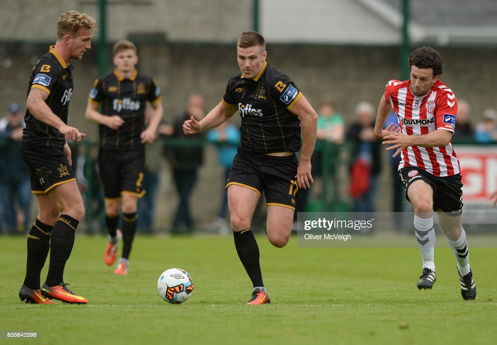 Buncrana , Ireland - 20 August 2017; John Mountney of Dundalk in action against Barry McNamee of Derry City during the SSE Airtricity League Premier Division match between Derry City and Dundalk at Maginn Park in Buncrana, Co Donegal.