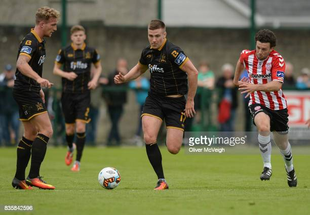 Buncrana Ireland 20 August 2017 John Mountney of Dundalk in action against Barry McNamee of Derry City during the SSE Airtricity League Premier...