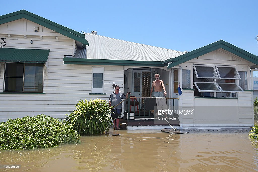 Bundaberg locals are stranded as flood waters rise as parts of southern Queensland experiences record flooding in the wake of Tropical Cyclone Oswald on January 29, 2013 in Bundaberg, Australia.Four deaths have been confirmed and thousands have been evacuated in Bundaberg as the city faces it's worst flood disaster in history. Rescue and evacuation missions continue today as emergency services prepare to move patients from Bundaberg Hospital to Brisbane amid fears the hospital could lose power.