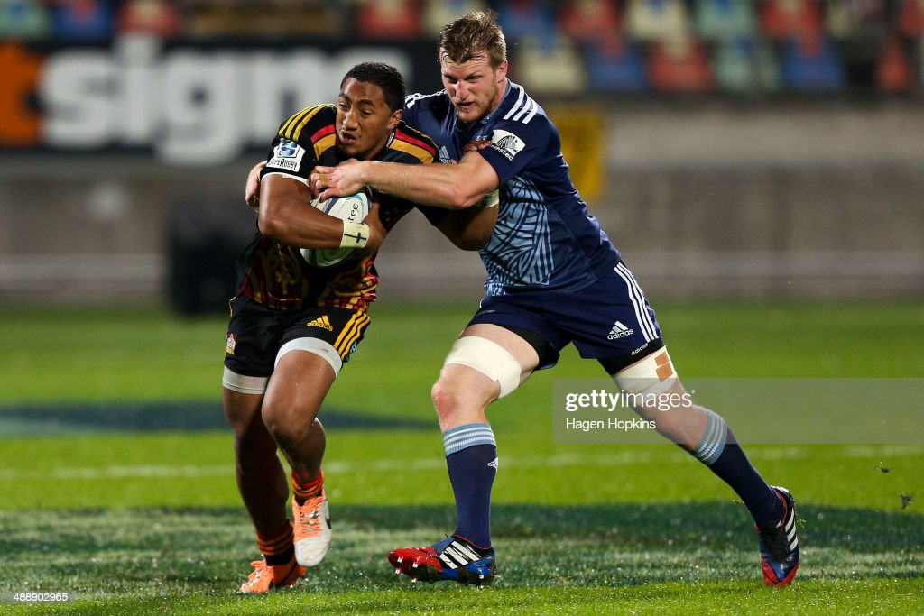 Bundee Aki of the Chiefs is tackled by <a gi-track='captionPersonalityLinkClicked' href=/galleries/search?phrase=Brendon+O%27Connor&family=editorial&specificpeople=5874311 ng-click='$event.stopPropagation()'>Brendon O'Connor</a> of the Blues during the round 13 Super Rugby match between the Chiefs and the Blues at Yarrow Stadium on May 9, 2014 in New Plymouth, New Zealand.