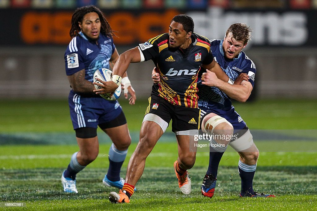 Bundee Aki of the Chiefs looks to offload in the tackle of <a gi-track='captionPersonalityLinkClicked' href=/galleries/search?phrase=Brendon+O%27Connor&family=editorial&specificpeople=5874311 ng-click='$event.stopPropagation()'>Brendon O'Connor</a> of the Blues during the round 13 Super Rugby match between the Chiefs and the Blues at Yarrow Stadium on May 9, 2014 in New Plymouth, New Zealand.