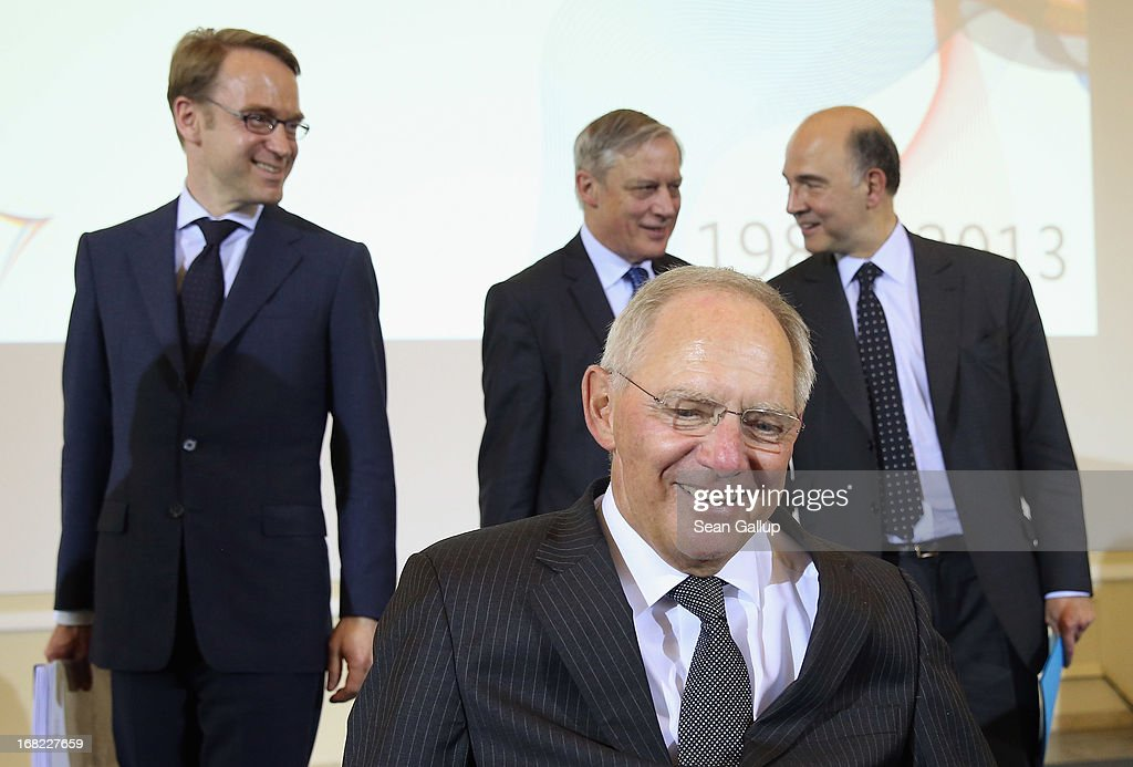 Bundesbank head <a gi-track='captionPersonalityLinkClicked' href=/galleries/search?phrase=Jens+Weidmann&family=editorial&specificpeople=6917233 ng-click='$event.stopPropagation()'>Jens Weidmann</a>, Banque de France Governor <a gi-track='captionPersonalityLinkClicked' href=/galleries/search?phrase=Christian+Noyer&family=editorial&specificpeople=2257224 ng-click='$event.stopPropagation()'>Christian Noyer</a>, German Finance Minister Wolfgang Schaeuble and French Finance Minister <a gi-track='captionPersonalityLinkClicked' href=/galleries/search?phrase=Pierre+Moscovici&family=editorial&specificpeople=667029 ng-click='$event.stopPropagation()'>Pierre Moscovici</a> arrive to speak to the media following events marking the 25th anniversary of the Franco-German Finance and Econimic Council on May 7, 2013 in Berlin, Germany. The Council was founded in 1988 to further not only economic relations between Germany and France but to create a further foundation for European economic stability.