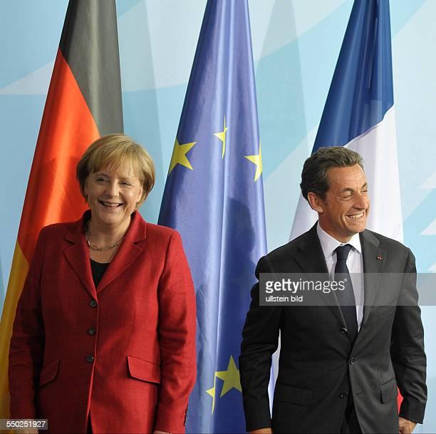 Bundeskanzlerin Angela Merkel und Staatspräsident Nicolas Sarkozy während einer gemeinsamen Pressekonferenz in Berlin