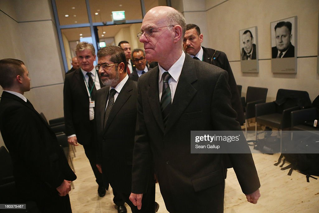 Bundestag President Norbert Lammert and Egyptian President Mohamed Mursi arrive while Lammert gave Mursi a brief tour of the Reichstag on January 30, 2013 in Berlin, Germany. Mursi has come to Berlin despite the ongoing violent protests in recent days in cities across Egypt that have left at least 50 people dead. Mursi is in Berlin to seek both political and financial support from Germany.