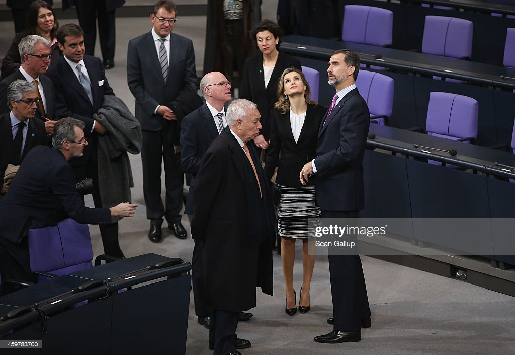 Bundestag President <a gi-track='captionPersonalityLinkClicked' href=/galleries/search?phrase=Norbert+Lammert&family=editorial&specificpeople=575522 ng-click='$event.stopPropagation()'>Norbert Lammert</a> (C, behind) gives King Felipe VI (R) and Queen Letizia of Spain a tour of the Bundestag plenary hall on December 1, 2014 in Berlin, Germany. King Felipe and Queen Letizia are on their first state visit to Berlin since assuming the Spanish throne.