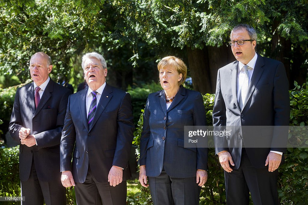 Bundestag President, <a gi-track='captionPersonalityLinkClicked' href=/galleries/search?phrase=Norbert+Lammert&family=editorial&specificpeople=575522 ng-click='$event.stopPropagation()'>Norbert Lammert</a>, President <a gi-track='captionPersonalityLinkClicked' href=/galleries/search?phrase=Joachim+Gauck&family=editorial&specificpeople=2077888 ng-click='$event.stopPropagation()'>Joachim Gauck</a>, German Chancellor <a gi-track='captionPersonalityLinkClicked' href=/galleries/search?phrase=Angela+Merkel&family=editorial&specificpeople=202161 ng-click='$event.stopPropagation()'>Angela Merkel</a> and Constitutional Court judge Andreas Voss Kuhle attend a commemoration ceremony at the Monument to the Victims of the Popular Uprising for the 60th anniversary of the uprising of workers in former East Germany on June 17, 2013 in Berlin, Germany. On June 17, 1953 workers in Berlin and other cities in communist East Germany went on strike and took to the streets in the first large-scale showing of popular discontent with the communist regime. Soviet troops intervened and quickly quelled the uprising with force.