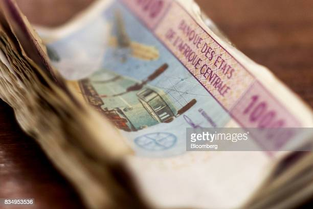 A bundle of 10000 denomination Central African franc banknotes sit in this arranged photograph in N'Djamena Chad on Wednesday Aug 16 2017 African...