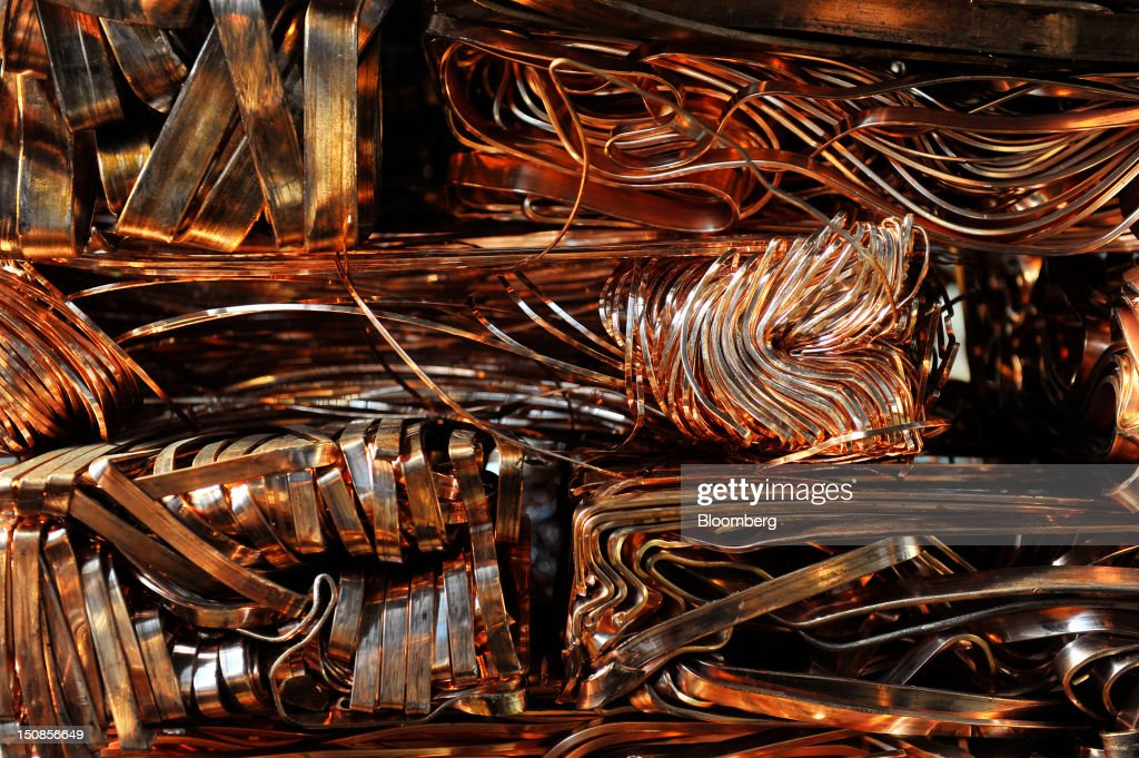 A bundle of pressed lengths of copper wire stand in a warehouse at the copper mining and smelting complex, operated by RTB Bor Group, in Bor, Serbia, on Friday, Aug. 24, 2012. Copper neared a one-week low in London on signs Asian economies are slowing and speculation that U.S. policy makers will refrain from a fresh round of stimulus. Photographer: Oliver Bunic/Bloomberg via Getty Images
