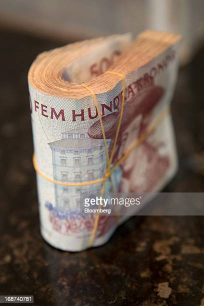 A bundle of Swedish 500 kronor notes are seen in this arranged photograph inside a currency exchange in Malmo Sweden on Tuesday May 14 2013 Sweden's...